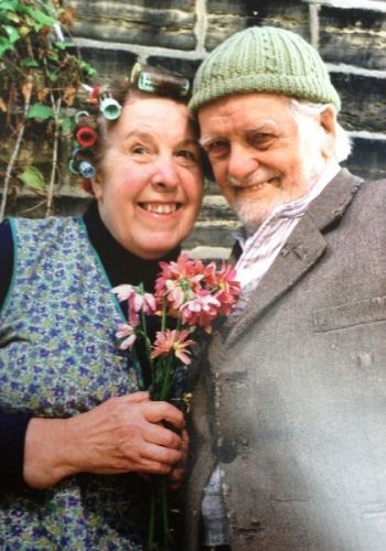 Nora & Compo with Pink Flower Photo