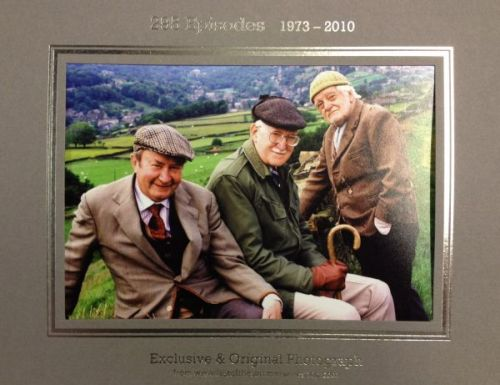 Three Men on the Hill with Compo Standing Photo
